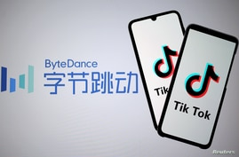FILE PHOTO: Tik Tok logos are seen on smartphones in front of a displayed ByteDance logo in this illustration taken November 27…
