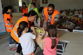 Children donate food to provide support to residents of Beirut, following Tuesday's blast, in Nicosia, Cyprus, Aug. 7, 2020.