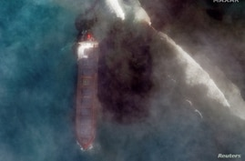 A satellite image shows the bulk carrier ship MV Wakashio and its oil spill after it ran aground off the southeast coast of…
