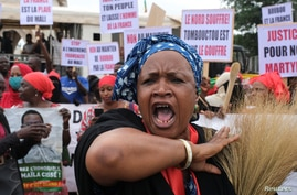 A protester shouts as she attends a mass protest demanding the resignation of Mali's President Ibrahim Boubacar Keita in Bamako…