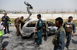 Afghan police officers inspect a vehicle from which insurgents fired rockets, in Kabul, Afghanistan August 18, 2020.REUTERS…