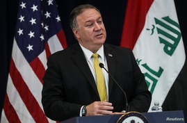 U.S. Secretary of State Mike Pompeo faces the news media with Iraq's Foreign Minister Fuad Hussein at the State Department.
