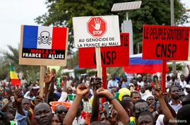 Opposition supporters attend a mass rally to celebrate the ousting of President Ibrahim Boubacar Keita (IBK), at the…