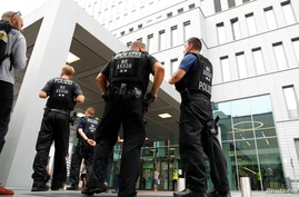 Police officers guard the surroundings of the Charite Mitte Hospital Complex, where Russian opposition leader Alexei Navalny is…