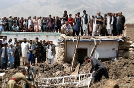 People search for victims after floods in Charikar, capital of Parwan province, Afghanistan August 27, 2020. REUTERS/Mohammad…