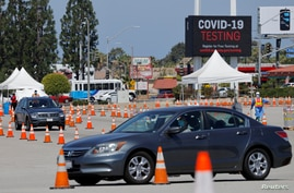 FILE PHOTO: A drive-through testing center is shown in operation during an outbreak of the coronavirus disease (COVID-19) in…