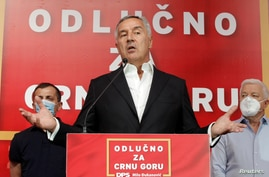Montenegrin President and leader of ruling Democratic Party of Socialists, Milo Djukanovic, speaks to the media after the general election in Podgorica, Montenegro, Aug. 30, 2020.