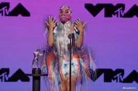 """Lady Gaga accepts the award for Best Collaboration for """"Rain On Me"""" during the 2020 MTV VMAs in this screen grab image made…"""