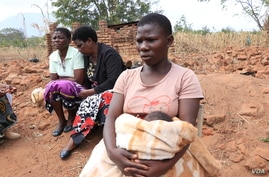 A teenage mother sits with other women, in Phalombe district, Malawi. (Lameck Masina/VOA)