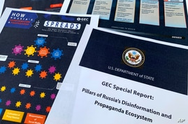 Pages from the U.S. State Department's Global Engagement Center report released on Aug. 5, 2020, are seen in this photo.
