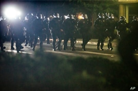Police respond to demonstrators gathered at Floyd Light City Park, Aug. 6, 2020 in Portland, Ore.