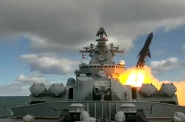 In this undated video grab provided by Russian Defense Ministry Press Service, Russia's Varyag missile cruiser fires.