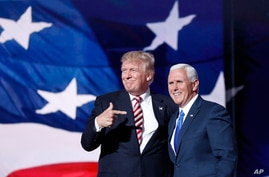 Republican presidential Candidate Donald Trump, points toward Republican Vice presidential candidate Gov. Mike Pence of Indiana…