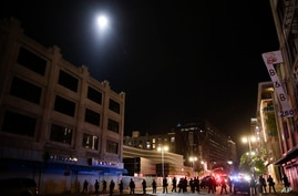 A police helicopter hovers over downtown Los Angeles as officers close in on a group of protesters Sunday, May 31, 2020. (AP…