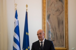 Greek Foreign Minister Nikos Dendias,speaks during a news conference with his Spanish counterpart Arancha Gonzalez Laya, after…