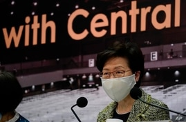 Hong Kong Chief Executive Carrie Lam listens to reporters' questions during a press conference in Hong Kong, Friday, Aug. 7,…