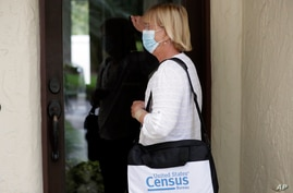 A census taker knocks on the door of a residence in Winter Park, Florida, Aug. 11, 2020.