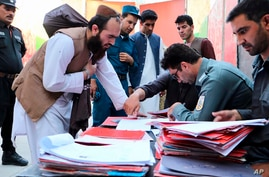Taliban prisoners are checked with documents as they are released from Pul-e-Charkhi jail in Kabul, Afghanistan.