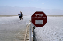A sign warns of extreme heat danger at Badwater Basin, Aug. 17, 2020, in Death Valley National Park, California.