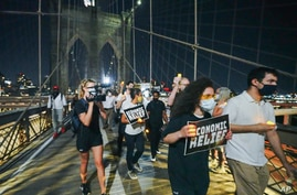 Photo by: John Nacion/STAR MAX/IPx 2020 8/21/20 Protesters arrive at the Brooklyn Bridge after a march all the way from the…
