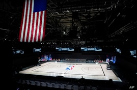 The court sits empty after a postponed NBA basketball first round playoff game between the Milwaukee Bucks and the Orlando…