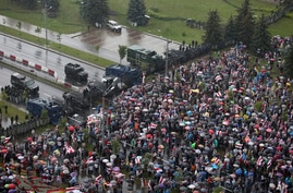 Belarusian opposition supporters gather in front of police line towards the Independence Palace, residence of the President Alexander Lukashenko in Minsk, Belarus, Aug. 30, 2020.