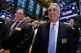 Kodak CEO Antonio Perez, right, is accompanied by company Chairman James Continenza, left, as they visit the New York Stock…