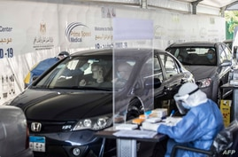 Egyptians get tested for Covid-19 at a drive-through coronavirus-testing center at the Ain Shams University in Cairo, June 29, 2020.