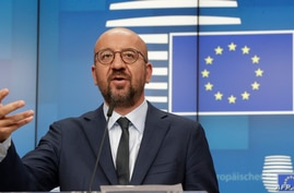 European Council President Charles Michel gestures as he speaks at a video press conference in Brussels, Belgium, Aug. 19, 2020.