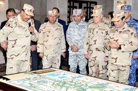 FILE - A handout picture released by the Egyptian Presidency Feb. 25, 2018, shows Egyptian President Abdel Fattah el-Sissi (R), dressed in uniform, during a visit to a regional military headquarters at an undisclosed location.
