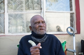 FILE - Fredie Blom celebrates his 116th birthday at his home in Delft, near Cape Town, South Africa, May 8, 2020.