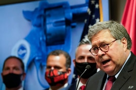 Attorney General William Barr talks to the media during a news conference about Operation Legend, a federal task force formed to fight violent crime in several U.S. cities, in Kansas City, Missouri, Aug. 19, 2020.