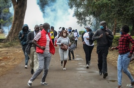Demonstrators run from teargas fired by police at a protest against alleged corruption, including the theft of supplies for the fight against the coronavirus, at Uhuru Park in downtown Nairobi, Kenya, Aug. 21, 2020.