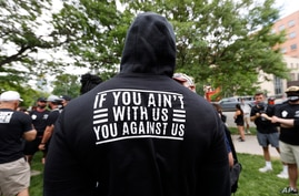 FILE - Denver Broncos linebacker Von Miller displays a message on the back of his hoodie as he takes part in a Black Lives Matter rally with teammates at Civic Center Park, in downtown Denver, Colorado, June 6, 2020.
