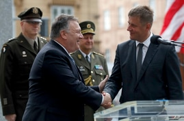 U.S. Secretary of State Mike Pompeo, front left, shakes hands with Czech Republic's Foreign Minister Tomas Petricek, right, during a ceremony at the General Patton memorial in Pilsen near Prague, Czech Republic, Aug. 11, 2020.