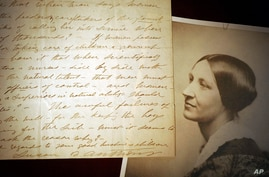 FILE - U.S. women's suffrage leader Susan B. Anthony is seen next to a 1898 letter handwritten by her, at an exhibit at The Karpeles Manuscript Library Museum, in Buffalo, New York, Jan. 10, 2005.