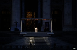 FILE - Pope Francis delivers the Urbi and Orbi prayer in an empty St. Peter's Square, at the Vatican, March 27, 2020.