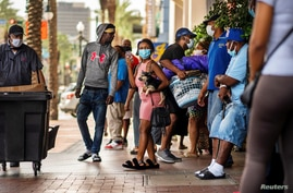 Evacuees from Lake Charles, Louisiana, are seen outside a hotel in New Orleans, Louisiana, Aug. 28, 2020. The state government has requested hotels make rooms available for those affected by Hurricane Laura.
