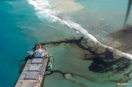 FILE - A general view shows the bulk carrier ship MV Wakashio that ran aground on a reef, at Riviere des Creoles, Mauritius, in this handout image obtained by Reuters Aug. 11, 2020. (French Army command/handout via Reuters)