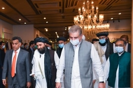 Taliban political affairs chief Mullah Abdul Ghani Baradar, center, heads for talks with Foreign Minister Shah Mehmood Qureshi, right, and Pakistani spy agency ISI chief Lt. Gen Faiz Hameed, left, in Islamabad, Aug. 25, 2020. (Photo courtesy of Pakistan Foreign Office)