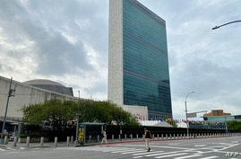 People walk on an empty First Avenue near the United Nations headquarters in New York on September 9, 2020. (Photo by Daniel…