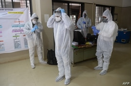 Medical staff wear Personal Protection Equipment (PPE) during a Covid-19 Coronavirus screening at the dedicated Covid facility…