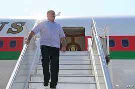 Belarus' President Alexander Lukashenko disembarks from a plane as he arrives at an airport in Sochi on September 14, 2020. …