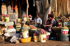 Women set up their shops at the Konyo Konyo market in Juba, May 12, 2012. South Sudan's citizens who paid in blood for their…