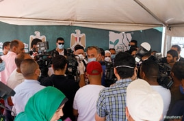 Journalists gather at a news conference with Egypt's Minister of Social Solidarity Nevin el-Qabbaj at the Egyptian Food Bank to…