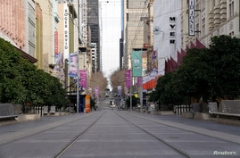 FILE PHOTO: Bourke Street mall, a normally busy shopping hub in Melbourne, is seen devoid of people after the city reimposed…