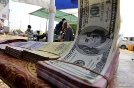 FILE PHOTO: Banknotes are displayed on a roadside currency exchange stall along a street in Juba, south Sudan, January 14, 2011…