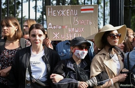 """Students protest against presidential election results in Minsk, Belarus September 1, 2020. The placard reads: """"Is power more…"""