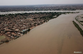 An aerial view shows buildings and roads submerged by floodwaters near the Nile River in South Khartoum, Sudan, Sept. 8, 2020.