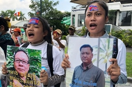 Relatives of arrested opposition politicians protest to demand their release, in front of the appeals court in Phnom Penh,…
